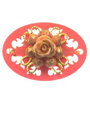 Coral flamenco brooch with golden highlights