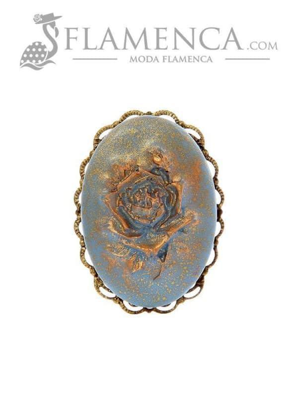 Broche de flamenca de resina azul ducado con reflejos oro