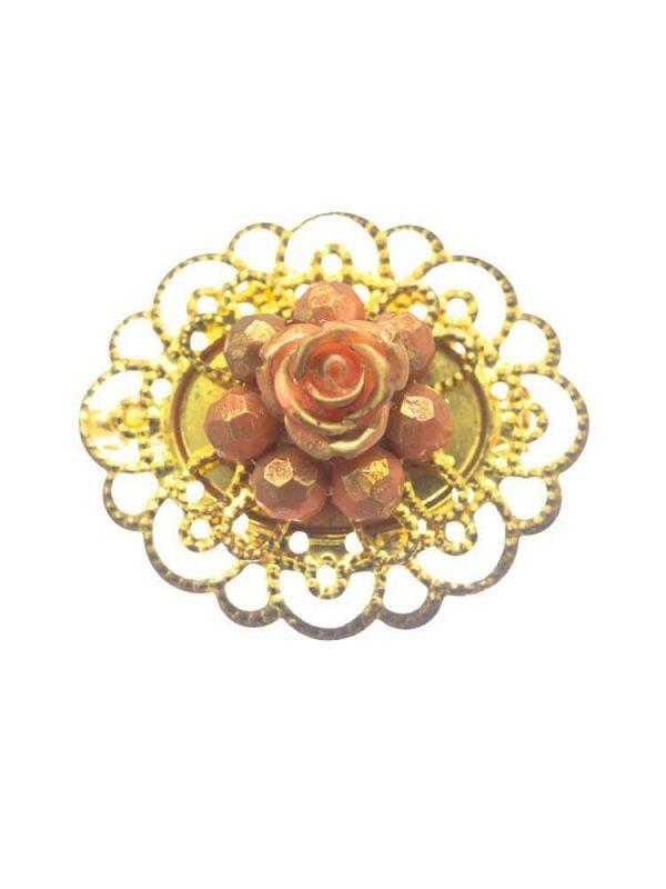 Broche de flamenca dorado con flor maquillaje