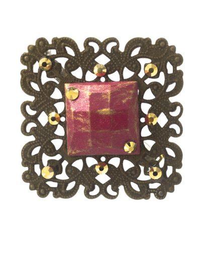 Broche de flamenca fresa con reflejos dorados