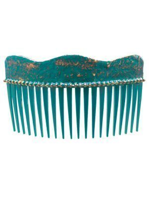 Flamenca wave comb with cracked sea water and golden reflections