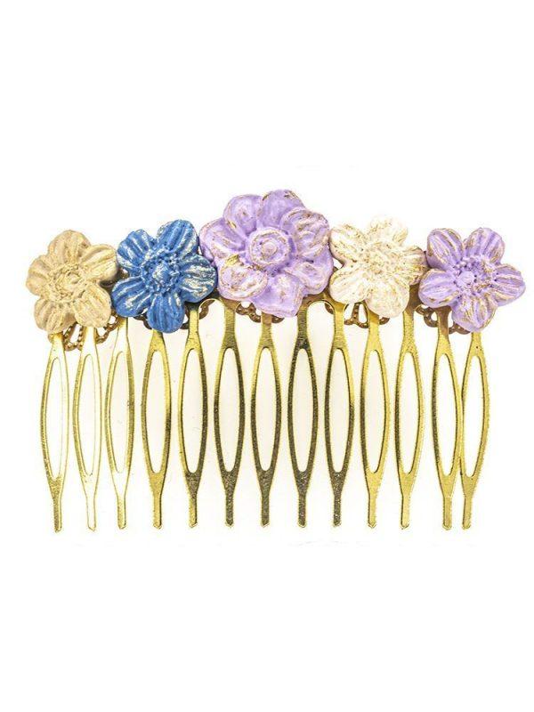 Peinecillo de porcelana en tonos lila, beige y azul con reflejos dorados